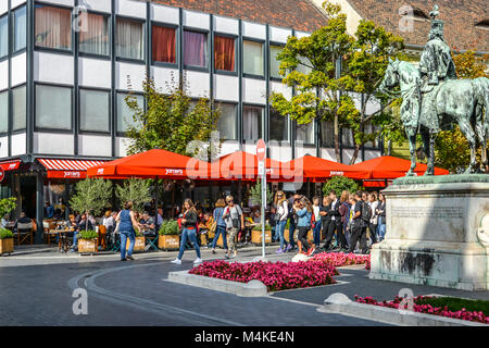 Equestrian statue of Andras Hadik next to Jameis Oliver's sidewalk cafe in Buda Castle District, Hungary, on - Stock Image