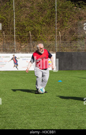 Middle-aged man taking part in a walking football session in Bolton, Lancashire, organised by Bolton Wanderers Community - Stock Image