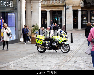 Motorbike Paramedic in Covent Garden checking his phone - Stock Image