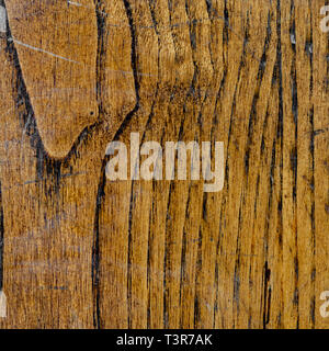 Walnut wood texture with vertical veins and scratches - Stock Image