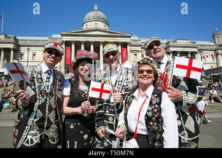 Trafalgar Square. London, UK. 20th Apr, 2019. 'Pearly Kings and Queens' attend the annual 'Feast of St George' event in Trafalgar Square, to celebrate the Patron Saint of England. St George's Day is on 23 April. Credit: Dinendra Haria/Alamy Live News - Stock Image