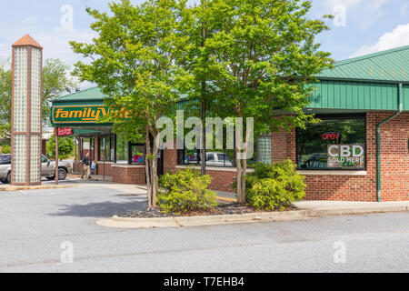 HICKORY, NC, USA-5/3/19: A Family Video store, with sign in window advertising CBD (cannabidiol) for sale. - Stock Image