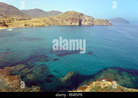 Barranco del Negro (Black Gorge) where it reaches the Cala de los Toros beach in the Cabo de Gata-Nijar Natural Park (Spain). - Stock Image