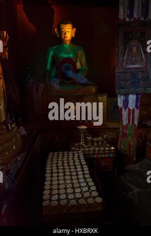 Lighting on Buddhist Deities in Gyangdrak monastery - Stock Image