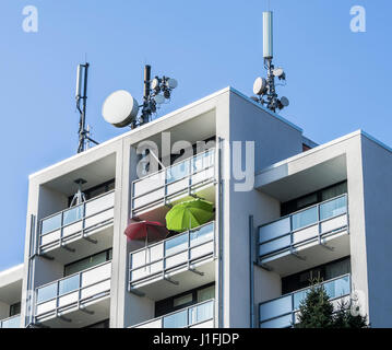 Radio mast, antenna, mobile communication set on top of apartment house, Celle, Germany - Stock Image