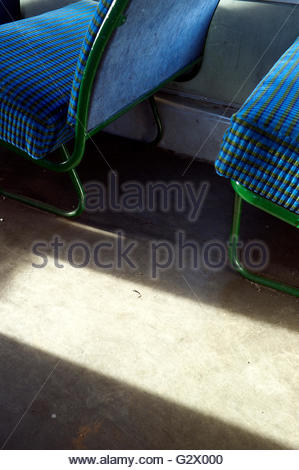 Vintage seating in a suburban railway carriage, UK. - Stock Image