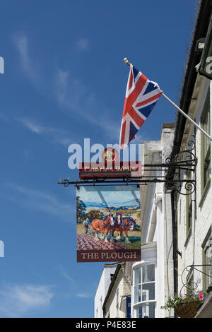 Hanging sign for the Plough Inn, a Charles Wells pub in the middle of the market town of Towcester, Northamptonshire, UK - Stock Image