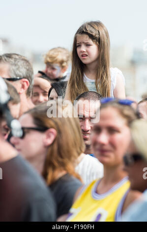 Portsmouth, UK. 29th August 2015. Victorious Festival - Saturday. A small girl sits on shoulders to see Texas play - Stock Image