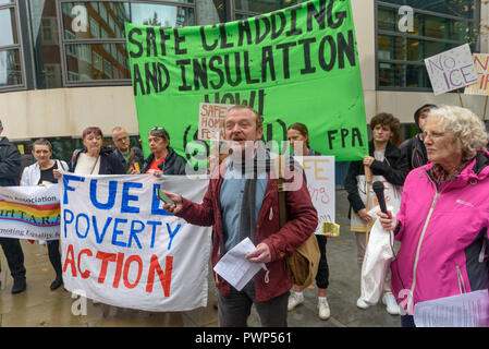 London, UK. 17th October 2018. Phil Murphy, former GMFRS Fire Safety Officer speaks at the protest outside the Ministry of Housing, Communities and Local Government by residents living in tower blocks covered in Grenfell-style cladding, Fuel Poverty Action, and Grenfell campaigners demanding that the government make all tower-block homes safe and warm. Credit: Peter Marshall/Alamy Live News - Stock Image