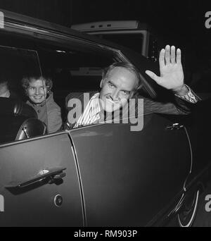1972 Presidential candidate Sen. George McGovern waves as he arrives at a fundraising concert in April 15, 1972 at The Forum in Los Angeles featuring James Taylor, Carole KIng, Barbra Streisand and Quincy Jones. - Stock Image