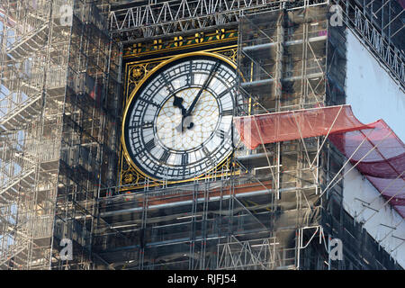 Big Ben clock covered with scaffolding, London, United Kingdom. - Stock Image