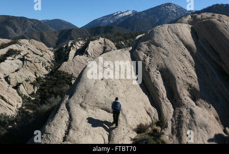 Hiker climber on cliffs in Devil's Punchbowl Natural Area, uplift from San Andres Fault County of Los Angeles - Stock Image