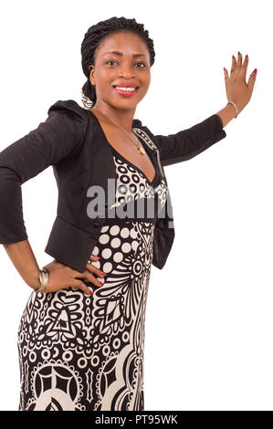 Portrait of beautiful business woman smiling left hand  to the wall and looking at the camera. - Stock Image