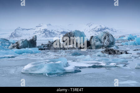 Panoramic view of the glacier lagoon Joekulsarlon with icebergs and in the background the glacier, winter in Iceland, Europe - Stock Image
