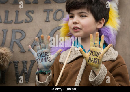 Inspired by Swedish teenager Greta Thunberg and organised by Youth Strike 4 Climate, British eco-aware school and college-age pupils protest about Climate Change inaction in Parliament Square during their walkout from classes, on 15th March 2019, in Westminster, London England. - Stock Image