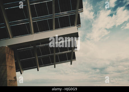 Close-up fragment of modern hi-tech solar photovoltaic panel with empty space for your message on the right, huge - Stock Image