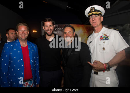 180831-N-NB544-1024 LOS ANGELES (Aug. 29, 2018) Rear Adm. Yancy Lindsey, Commander, Navy Region Southwest, and Jonathan Williams, president of Los Angeles Fleet Week (LAFW) Foundation, on board the Battleship USS Iowa for the world premiere of Tom Clancy's TV series 'Jack Ryan' during Los Angeles Fleet Week (LAFW) 2018. LAFW is an opportunity for the American public to meet their Navy, Marine Corps and Coast Guard teams and experience America's sea services. During fleet week, service members participate in various community service events, showcase capabilities and equipment to the community, - Stock Image