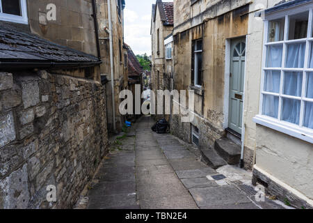 A short pedestrian cut through on Silver Street in the historical town of Bradford on Avon in Wiltshire - Stock Image