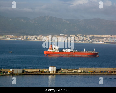 Tanker and Yacht Gibraltar Harbour Europe - Stock Image