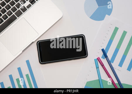 Top view or Flat lay style for business with copy space. Workspace with smartphone, laptop , stationery isolated on white table background - Stock Image