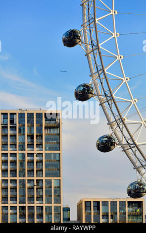 Millennium Wheel / London Eye and buildings on the South Bank, London, England, UK. Plane in the sky - Stock Image