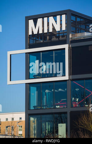 The BMW Mini sign on the showroom and offices of Cooper BMW in Reading, Berkshire. - Stock Image