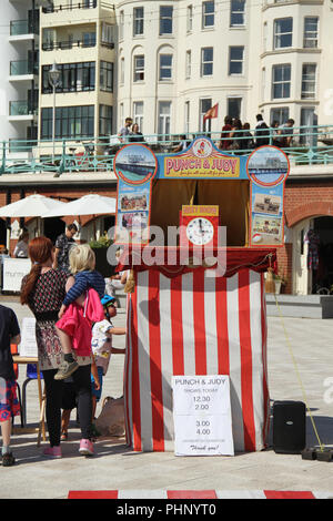Brighton, UK - September 1 2018: A Punch and Judy stall by the Brighton beach showing schedule for the next show on 1​ September 2018.   The Pier, in the central waterfront section, opened in 1899 houses amusement rides as well as food kiosks.Credit: David Mbiyu /Alamy Live News - Stock Image