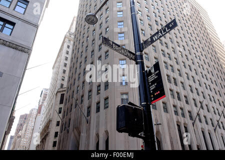 Corner of Wall St and Broadway sign in New york, NY, USA, United States of America in Summer. - Stock Image
