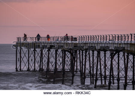 Saltburn-by-the-Sea. 12th Feb 2019. Weather: Dawn on the coast at Saltburn-by-the-Sea on the north-east coast with people fishing from Saltburn Pier. 12th February 2019. © Gary Clarke/Alamy Live News - Stock Image