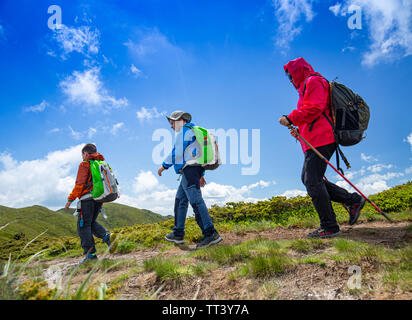 Mother and two boys hike on the mountain trail - Stock Image