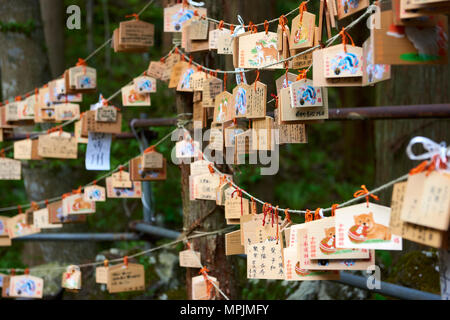 Detail of prayer blocks hanging outside Towada Shinto shrine. The blocks, called Ema, is used for worshippers to write prayers and wishes. - Stock Image