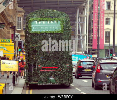 "Glasgow, Scotland, UK. 14th July, 2019. The green man visit ed glasgow today as the upmarket  A Lister restaurant ""THE IVY"" promoted its new out of London restaurant as the team tours the city with an ivy covered double decker. Gerard Ferry/Alamy Live News - Stock Image"