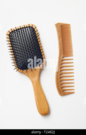 Bamboo Comb and Hairbrush On White Background - Stock Image