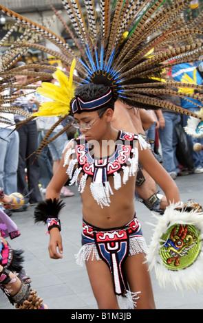 Young Mexican Boy Dancing in Aztec Costume, Zocalo Square, Plaza de la Constitucion, Mexico City, Mexico - Stock Image
