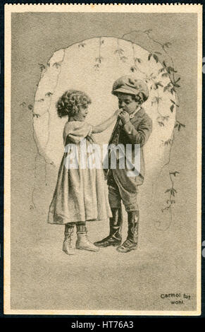 GERMANY - CIRCA 1914: A promotional postcard (Carmol tut wohl) printed in Germany, shows a boy kissing a girl's - Stock Image