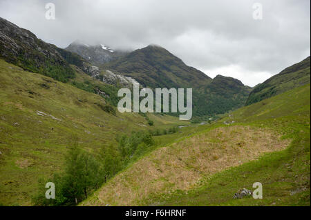 Looking back along glen nevis toward the tiny mountain rescue hut and the mountains above the falls of Allt Coire - Stock Image