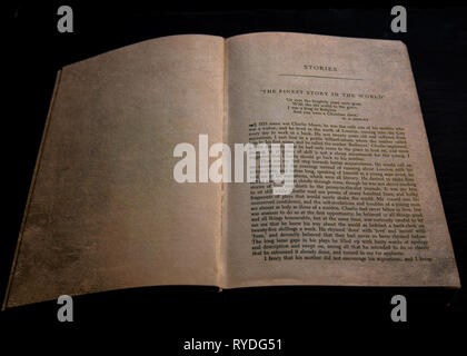 "An old open book at the beginning of the story ""The finest man in the world"" by Rudyard Kipling , against black background - Stock Image"