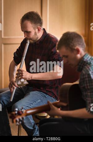 Kelso Folk Festival 2018 (annual event). Scott Garden (Irish Low Whistle) and Scott Figgins (guitar) in concert. - Stock Image
