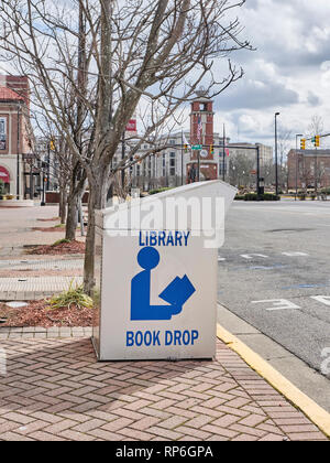 Library book drop box on a city street, curb side, in Montgomery Alabama, USA. - Stock Image