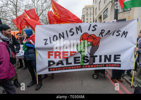 London, UK. 16th March 2019. Free Palestine banner states 'Zionism is Racism'.Thousands march through London on UN Anti-Racism day to say 'No to Racism, No to Fascism' and that 'Refugees Are Welcome Here', to show solidarity with the victims of racist attacks including yesterdays Christchurch mosque attack and to oppose Islamophobic hate crimes and racist policies in the UK and elsewhere. The marchers met in Park Lane where there were a number of speeches before marching to a rally in Whitehall. Marches took place in other cities around the world including Glasgow and Cardiff. Peter Marshall/A - Stock Image