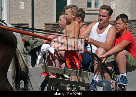 Gypsy Travellers riding on trotting cart. Appleby Horse Fair 2018. The Sands, Appleby-in-Westmorland, Cumbria, England, United Kingdom, Europe. - Stock Image
