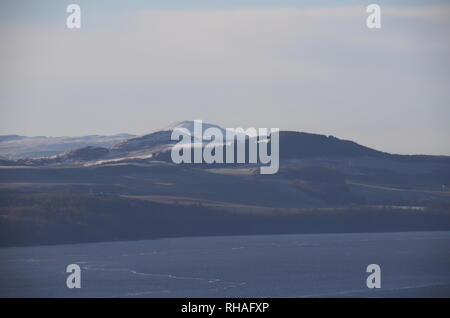 Distant view of Normans Law and snow capped West Lomond Fife Scotland  January 2019 - Stock Image