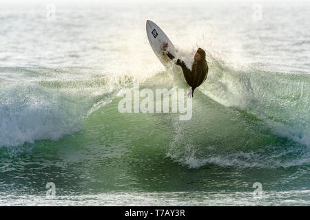 Spectacular surfing action at popular surfing hotspot Fistral beach in Newquay in Cornwall. - Stock Image