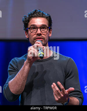 Bonn, Germany - June 8 2019: Steven Strait (*1986, American actor and model - The Expanse) talks about his experiences in The Expanse at FedCon 28 - Stock Image