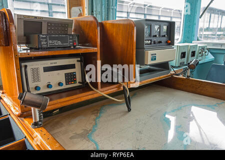 Navigation equipment and map desk on the Bridge of the Royal Yacht Britannia, Port of Leith, Edinburgh, Scotland, UK - Stock Image