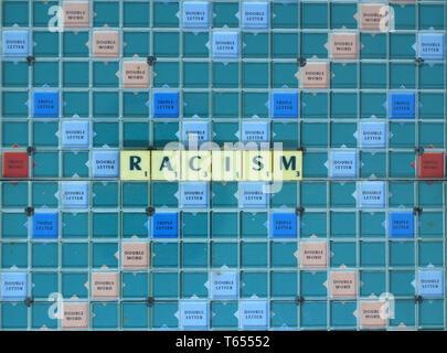 Racism written in Scrabble tiles - Stock Image