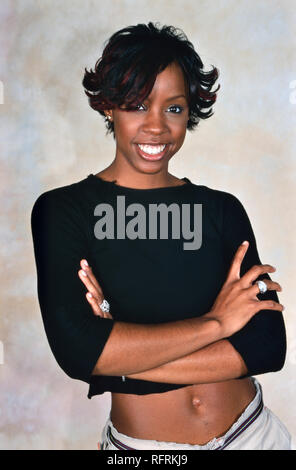 LONDON, ENGLAND - NOV 18, 2000: Kelly Rowland singer of Destiny's Child during a photoshoot in London. Original photo is a slide. - Stock Image