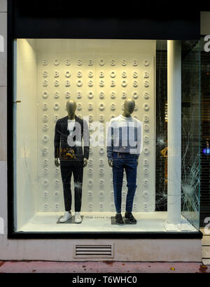 Broken windows of Hugo Boss store following May First and Yellow Jackets manifestation in Montpellier, France, May 1, 2019 - Stock Image