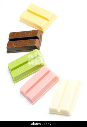 Variety of KitKat flavours from Japan. (sweet potato, red bean, green tea, raspberry, sake) - Stock Image