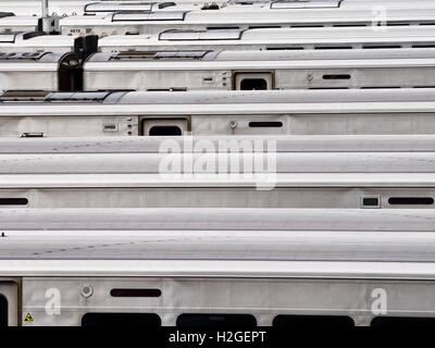 Abstract photograph of MTA Long Island Railroad cars in the Hudson Yards rail yard in NYC seen from the High Line - Stock Image
